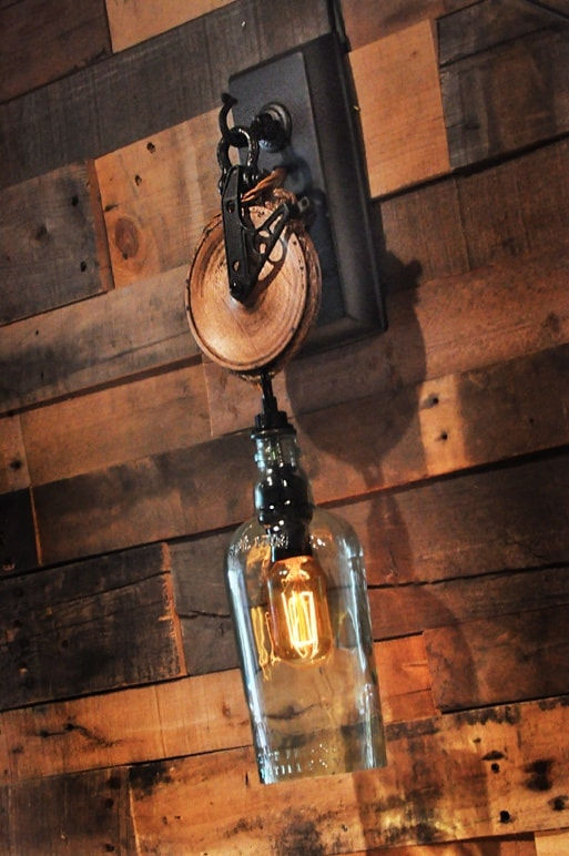 Wooden Pulley Wheel Wall Sconce With Recycled Gin Bottle