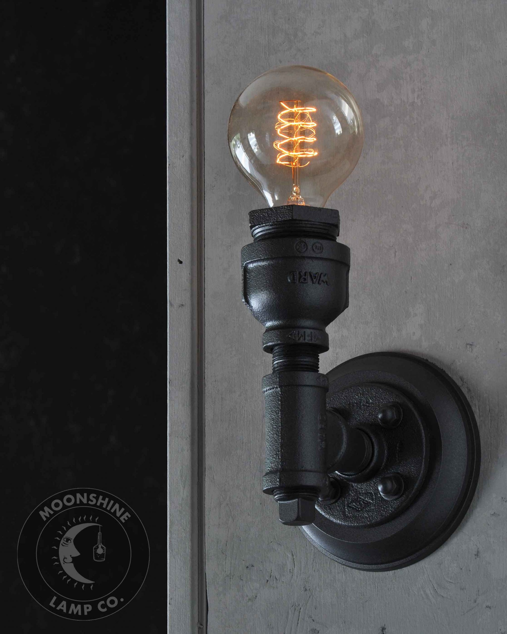 Industrial Pipe Wall Sconce With Customizable Finish And Edison Bulb Moonshine Lamp Company
